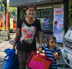 Happy lady (Beegee49) Tags: street people woman filipina child girl happy planet sony city philippines asia bacolod a6000