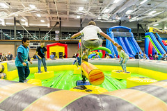 Leaping Over a Rotating Obstacle (aaronrhawkins) Tags: rotation inflatable fun bounce jump leap arm sweep fall rotate challenge midair kids boy girl child children toys party provo recreation center action utah joshua aaronhawkins