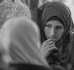 Day Dreaming (ybiberman) Tags: israel jerusalem oldcity alquds muslimquarter woman hijab candid streetphotography bw blackandwhite interested fingers grocerystore