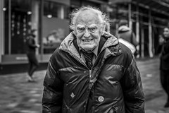 Grimace (Leanne Boulton) Tags: urban street candid portrait portraiture streetphotography candidstreetphotography candidportrait streetportrait eyecontact candideyecontact streetlife old elderly man male face eyes expression grimace mood emotion feeling eyebrows hair tone texture detail depthoffield bokeh naturallight outdoor light shade city scene human life living humanity society culture lifestyle people canon canon5dmkiii 70mm ef2470mmf28liiusm black white blackwhite bw mono blackandwhite monochrome glasgow scotland uk