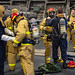 Sailors assigned to USS Montgomery dress out in firefighting gear during damage control drills