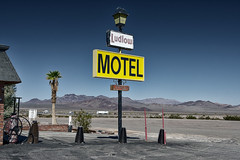 motel / route 66. mojave desert, ca. 2014. (eyetwist) Tags: eyetwistkevinballuff eyetwist ludlow motel route66 sign mojavedesert nikkor nikon d7000 nikond7000 18200mmf3556gvrii 18200mm photoshop plugin processed postprocessed filter nik color efex silver nikcolorefex niksilverefex graphic contrast landscape multiply american west arid highdesert type typographic typography yellow hotel overnight roadsideamerica roadtrip route 66 california interstate i40 40 vacancy rooms bleached mojave desert