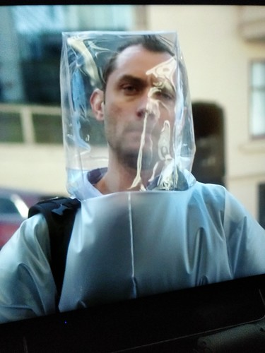 Jude Law in a full body protective suit in Contagion