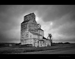 superstructure (Gordon Hunter) Tags: grain elevator silo bin prairies farming agriculture old building white peeling paint storm clouds dark bw mono country rural canada ab gord hunter nikon d5000 abandoned decay