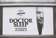 Doctor Sleep (goodfella2459) Tags: nikonf4 afnikkor24mmf28dlens ilfordhp5plus400 35mm blackandwhite film analog sign poster advertisement london cinema leicestersquare doctorsleep stephenking theshining bwfp
