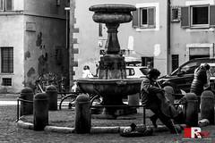 sunday morning, in Rome. (Michele Rallo - MR PhotoArt) Tags: michelerallomichelerallomrphotoartemmerrephotoartphotopho trastevere piazza plaza piazzetta san simeone bn bianco e nero black white musician music musicist
