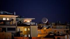 moonset over the roofs (athanecon) Tags: moon newmoon crescent crescentmoon luna lune moonset citylights cityscape closeup closeupphoto nightlights nightview nightsky night light lights roof moonsetovertheroofs nikon nikond750 nikonphotography nikon28300 nikon28300mm
