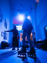 Skatetown, USA (Zack Huggins) Tags: olympusomdem5markii olympusmzuikoed12mmf2 vscofilm pack01 dallastx oakclifftx texastheatre skatetownusa rollerskates rollerskating rollerblades blue dj danceparty tuesdaynighttrash tnt lowlight lowangle rnifilms availablelight bokeh dof microfourthirds backlight backlit shadow silhouette lobby movietheater