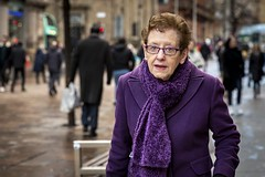 Deep Purple (Leanne Boulton) Tags: urban street candid portrait portraiture streetphotography candidstreetphotography candidportrait streetportrait eyecontact candideyecontact streetlife old elderly woman female lady face eyes expression mood emotion feeling style fashion stylish colourful purple glasses scarf winter coat tone texture detail depthoffield bokeh naturallight outdoor light shade city scene human life living humanity society culture lifestyle people canon canon5dmkiii 70mm ef2470mmf28liiusm colour glasgow scotland uk