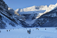 Skating on Lake Louise (Anthony Mark Images) Tags: skating skatingonlakelouise frozenlake lakelouise banffnationalpark beautifulmorning skaters people mountains snow ice snowcoveredtrees beeautiful lovely alberta canada nikon d850 flickrclickx winter winterfun wintersports fun