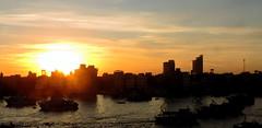 Sunrise (Khaled M. K. HEGAZY) Tags: nikon coolpix p520 raselbar egypt nature outdoor closeup sun sunrise sky cloud nile river water boat building silhouette yellow blue brown white orange black