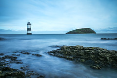 All at sea... (judi may) Tags: landscape longexposure lighthouse penmonpoint penmonlighthouse anglesey wales beaumaris sea water coast rocks boulders seascape blue canon5d sky
