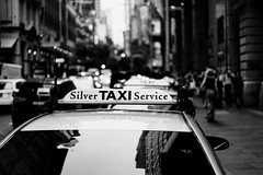 Leaving Sydney (McLovin 2.0) Tags: taxi street streetphotography urban city sydney monochrome bw bokeh sony a7s 55mm zeiss reflection traffic explore explored australia lights