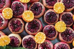 Pomegranates & Oranges (Poupetta) Tags: pomegranate oranges telaviv market fruits yummy