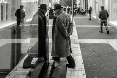 The Man in the Coat (Umberto Lucarelli) Tags: streetphotography coat blackandwithe naples symmetries