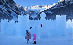 Ice Castle (Anthony Mark Images) Tags: icecastle art snow people motherdaughter pinkcoats mountains lakelouise snowcoveredtrees beautiful banffnationalpark alberta canada pretty lovely nikon d850 flickrclickx