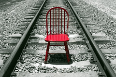 Where We Travel (D()MENICK) Tags: red chair railroad tracks selective color