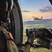 UH-60 Blackhawk helicopters and a CH-47 Chinook conduct air assault operations near Wheeler Army Airfield