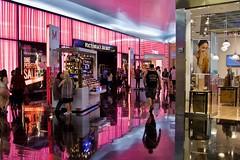 Reflect (Rick Del Carmen) Tags: shoppingmall colors reflections shops stores people menwomen kiosk vendor streetphotography