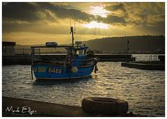 Golden Fleece (Mark Edgar) Tags: larne water sea moored northernireland coantrim islandmagee goldenclouds goldenlight sunset harbour blueboat boat goldenfleece