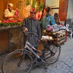 Riding Home For Christmas (Martin Tidbury) Tags: man bike turkey streetphotography meat panasonic butcher morocco marrakech souk streetphoto panasonicdmcgx8 hat coat christmas bicycle cycle