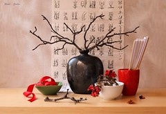 In Japanese Style (Esther Spektor - Thanks for 16+millions views..) Tags: art composition creativephotography stilllife naturemorte bodegon naturezamorta stilleben naturamorta tabletop vase branch flowers cup bowl ribbon fan petal paper calligraphy letters japanese ceramics reflection ambientlight white red green black estherspektor canon