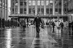 Marching On (Leanne Boulton) Tags: street urban candid streetphotography streetlife urbanlandscape candidstreetphotography man reflection male wet face weather walking mood pavement expression atmosphere business sidewalk busy rush stride puddle detail texture bokeh depthoffield tone light outdoor naturallight shade life city people living humanity culture lifestyle scene human society uk blackandwhite bw white black monochrome canon mono scotland blackwhite glasgow 70mm canon5dmkiii ef2470mmf28liiusm