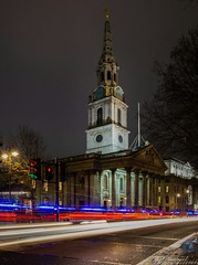 Passing by (Through_Urizen) Tags: canon canon1585mm canon70d outdoor street road lightsatnight lights streetlights policecar bus traffic church placeofworship tower spire columns architecture architecturephotography uk greatbritain england london trafalgarsquare stmartininthefield