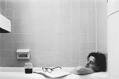 And Relax (Gabriella Ollandini) Tags: lady tub 35mm woman film istillshotfilm bw monochrome analog analogu analogica portrait candid bath ricoh ilford hp5 grain book filmcamera lomo blackandwhie minimal mature bwfp reading filmphotography filmisnotdead 50mm private alone selfportrait vintage retro bathroom relaxing peace quiet drinking sleeping napping soaking washing