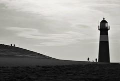 People at the lighthouse (peer.heesterbeek) Tags: lighthouse people dog coast street blackwhite monochrome zeeland netherlands