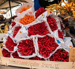 Little Peppers (UrbanphotoZ) Tags: venice italy wrapped peppers venezia littlepeppers red orange gourds yellow box tent bunch bouquet mercatocentrale litoralecavallino trepporti