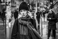 Decisions (Leanne Boulton) Tags: urban street candid portrait portraiture streetphotography candidstreetphotography candidportrait streetportrait streetlife woman female girl face eyes expression mood emotion feeling blonde hair wind windy beanie cold winter weather scarf tone texture detail depthoffield bokeh naturallight outdoor light shade city scene human life living humanity society culture lifestyle people canon canon5dmkiii 70mm ef2470mmf28liiusm black white blackwhite bw mono blackandwhite monochrome glasgow scotland uk
