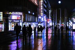 Water colors (Nathalie_Désirée) Tags: rainy wet reflection sonyαmo rain weather evening stuttgart pedestrian passage sonyalpha7rii sonyalpha7r2 samyang85mmf14 color colorful wonderful beautiful amazing outstanding badenwuerttemberg badenwürttemberg germany europe königstrasse center city night urban people human person umbrella nighttime shadow shadows silhouette building cinema shops shopping hat walk walking walker floor ground tile tiles serenade serenity peace peaceful happy calm serene sidewalk stairs königsbau koenigsbau koenigstrasse königstrase stuttgartmitte outdoors darkness light everyday inspiring moody atmosphere ambience ambiance mood steps mercedesbenz bahnhofsturmstuttgart