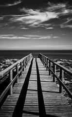 Harsh shadow (Vest der ute) Tags: g7xm2 g7xll spain fence sea sky clouds mono shadows beach fav25