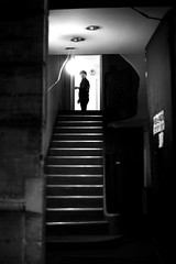 At the front door (pascalcolin1) Tags: paris13 homme man escalier stairs marches steps nuit night lumière light ombres shadows porte door frontdoor portedentrée up photoderue streetview urbanarte noiretblanc blackandwhite photopascalcolin 50mm canon50mm canon
