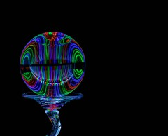 The Light Inside (Karen_Chappell) Tags: led glow black ball orb sphere round glass circle abstract stilllife lightpainting longexposure rgb red green blue colour color colours colors colourful multicoloured refraction lights light pattern lines shapes