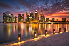 Glowy Bayfront (Scintt) Tags: singapore wideangle traditional city cityscape hall marinabay rafflesplace tanjongpagar financial cbd central business district offices towers skyscrapers skyline sky clouds sun light contrast tones travel tourism architecture buildings urban modern exploration steps waterfront scintt scintillation jonchiangphotography fullerton bridge hotel expensive processed neutraldensity sony a7rii 1635 golden reflection clear sunset dusk evening iconic hny water lake pond reservoir cloud dramatic orange red glow longexposure slowshutter night blue esplanade afterglow lighttrail reflections jubilee
