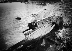 Wrecked boat (Missing Pictures) Tags: atmosphere mood shot white black europe abandoned exploring explore traveling travel decay water sea blackandwhite bw monochrome russia north boat wrecked absoluteblackandwhite