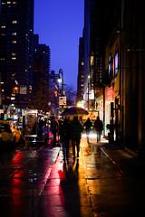 EightySixthStreet (m_laRs_k) Tags: nyc nikon 50mm z50mmf18s usa nikkor 86thstreet newyork newyorkcity 2019 night bluehour street paraplui regenschirm umbrella 纽约 雨伞 夜晚 cool couple walk reflection reflexion stoplights red skyscrapers urban cityscape walking motion f18 travel vacation manhattan z z6 mirrorless spiegellos purplehour lightroomed lr6 prime festbrennweite nifty crossing subway 456 winter fun normal standard amerika nord bigapple sidewalk gehweg regen portrait crop 23 colors vivid dngconverter tag yorkville eastside lexingtonavenue stroll silhouette backlit backlight gegenlicht farbspektrum chrome