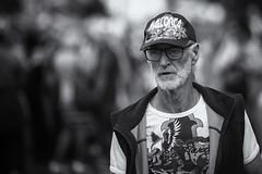 Mallorca man (Frank Fullard) Tags: frankfullard fullard candid street portrait ballycastle ireland northernireland antrim fair lammas black white blanc noir monochrome mallorca cap tshirt beard
