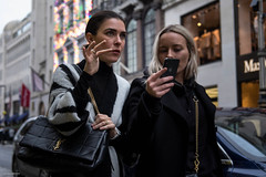 YSL (Silver Machine) Tags: london mayfair streetphotography street streetportrait candid woman mobilephone shopping walking handbag ysl yvessaintlaurent blonde brunette fujifilm fujifilmxt10 fujinonxf35mmf2rwr