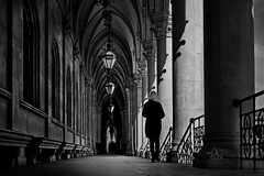 arcades (heinzkren) Tags: schwarzweis blackandwhite monochrome street streetphotography architecture building city urban candid vienna woman canonr eosr old pillars light shadow innamoramento