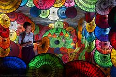 Kaleidoscope Man (pdxsafariguy) Tags: art burma artwork asia asian bagan colorful decoration display handicraft market shop man shopkeeper myanmar oriental ornamental umbrella tomschwabel parasol