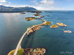 Storseisundet Bridge - Atlantic Ocean Road (Norway) (Andrea Moscato) Tags: andreamoscato norvegia norge bokmål nynorsk north europe view vivid vista day light luce shadow ombre blue white red yellow water sea art artist nature natura natural naturale fiordo fiord mare landscape trail history historic panorama tourist attraction rock stones dji mavic air quadcopter drone overlook island green street road grass bridge ponte isola deep ocean oceano car boat clouds sky nuvole cielo atlantic waves strada