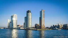 Rotterdam, Netherlands: Wilhelminaplein skyline viewed from Nieuwe Maas (nabobswims) Tags: hdr highdynamicrange ilce6000 lightroom mirrorless nl nabob nabobswims netherlands nieuwemaas photomatix rotterdam sel18105g sonya6000 wilhelminaplein zuidholland