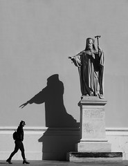 Blessed... (Michael Kalognomos) Tags: sony sonyalpha photography streetstories streetlife streetphotography sony35mmf18oss woman lady girl statue priest shadow blackandwhite bw sonya6400 cinematography athens greece light sun blessed