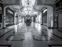 Quiet in the shopping centre (aquanout) Tags: blackandwhite bw monochrome interior indoors shops lights phoneshot