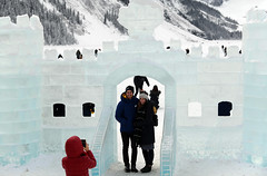 "Say ,""Cheese"" (Anthony Mark Images) Tags: couple smiles handsomeguy prettygirl redcoat cellphonephotographer icecastle ice icesculpture takingphotos mountains snow snowcoveredtrees lakelouise lovely banffnationalpark beautiful alberta art canada people portrait nikon d850 flickrclickx"