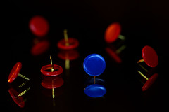 red or blue, they function the same (HansHolt) Tags: red blue thumbtack drawingpin punaise mirror spiegel reflection reflectie spiegeling plastic metal metaal tabletop focus dof macro canon 6d 100mm canoneos6d canonef100mmf28macrousm macromondays theoddone hmm