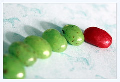 jelly beans (overthemoon) Tags: macromondays jellybeans green red line curve theoddone sweets confectionery